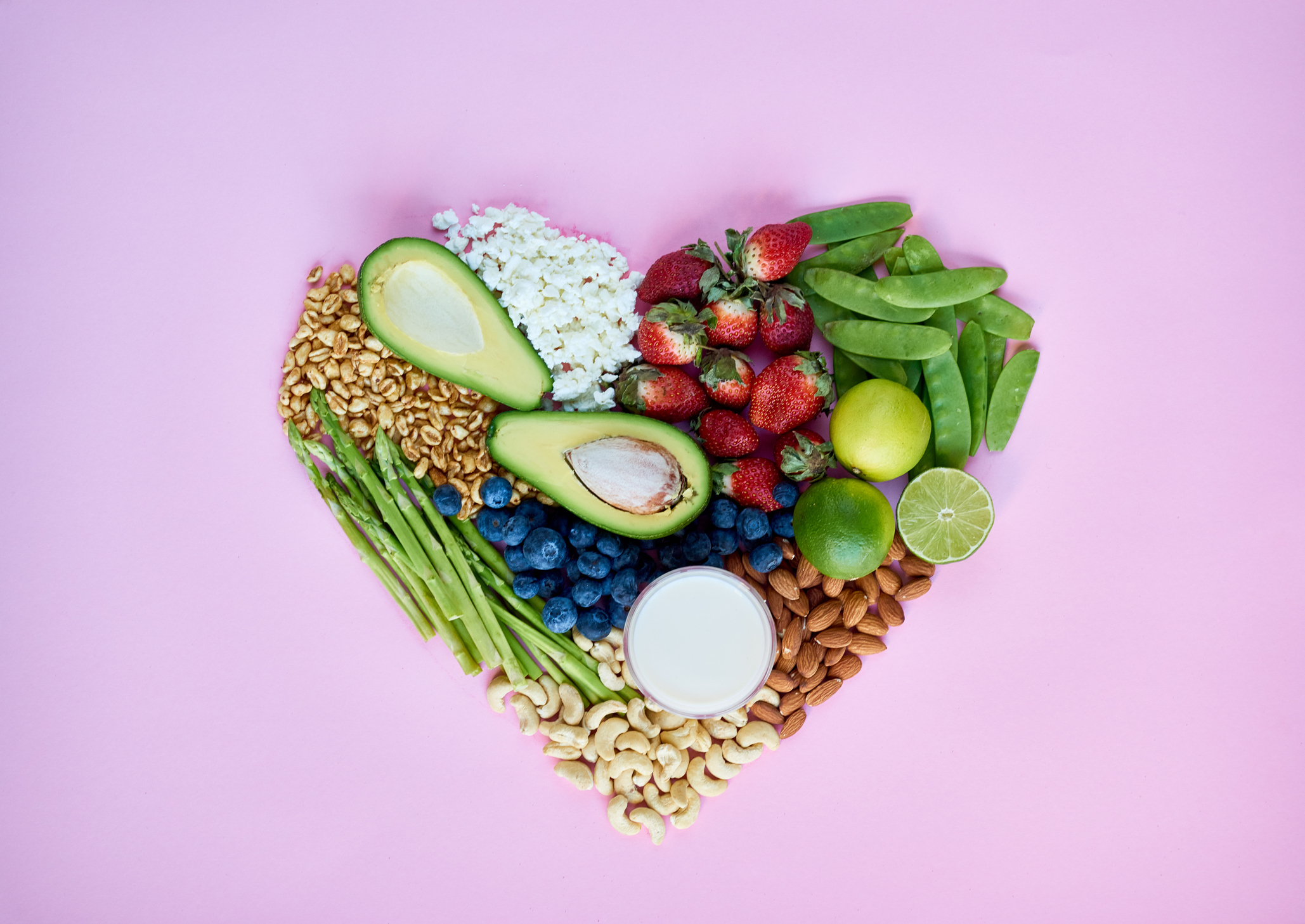Nuts, berries, vegetables and fruits in shape of heart